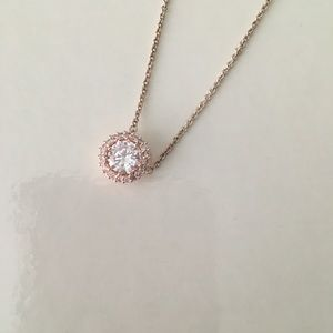 """Rose gold colored necklace with clear """"stones"""""""